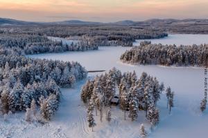Blockhütten Winterreise Lappland