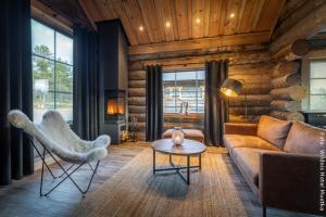 Hotel Muotka Lappland Lodge - Blockhütte am Fluss - Wohnbereich
