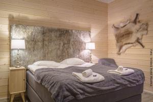 Hotel Muotka - Doppelbett im Superior Zimmer
