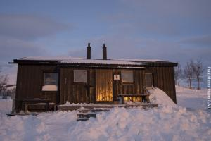 Schneemobil Safari Schweden - Hütte