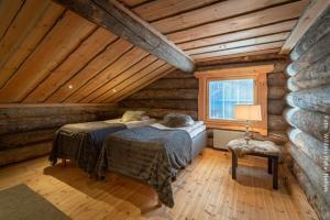 Einzelbetten in Blockhütte Kasari