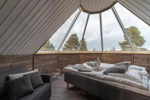 Doppelbett in Nordlichter Hütte